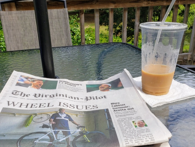 Virginian Pilot newspaper and iced coffee