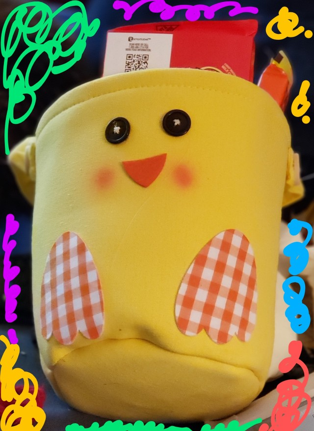Yellow fabric basket decorated to look like a chick