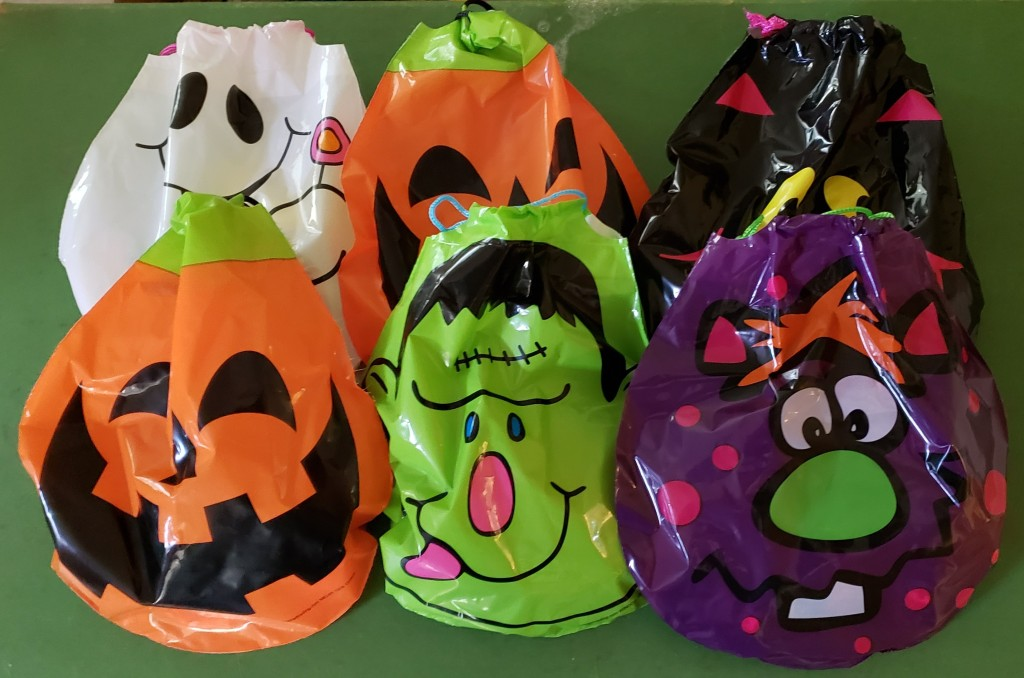 An assortment of Halloween themed drawstring bags filled with candy