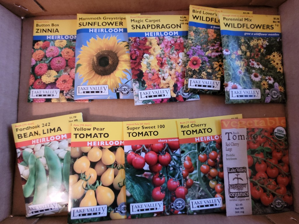 A collection of flower and tomato seed packets