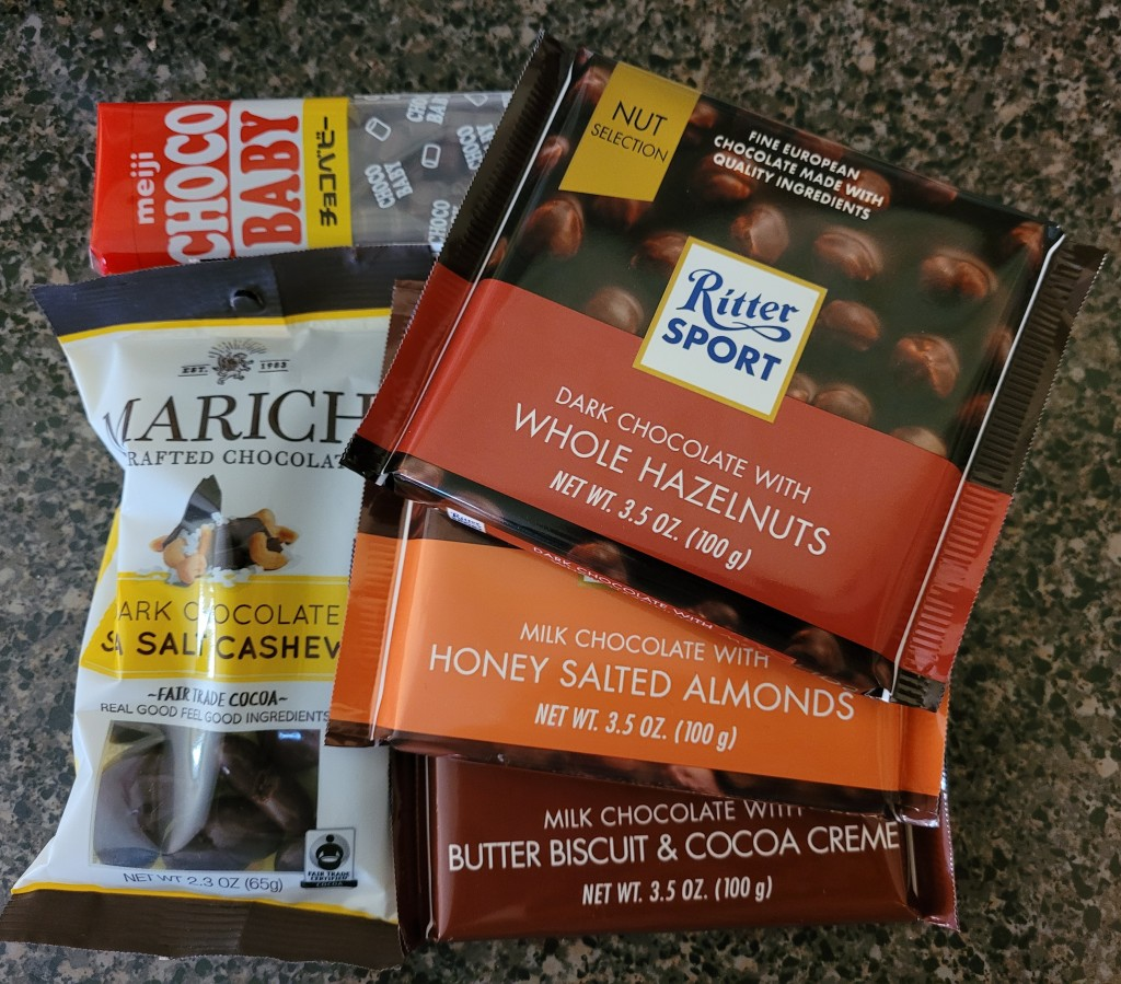 Choco baby candies, chocolate covered cashews, and Ritter Sport chocolate bars