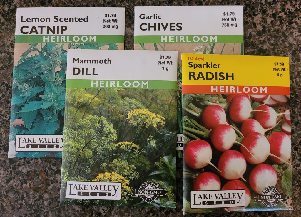 Seed packets for Catnip, Dill, Chives, and Radishes