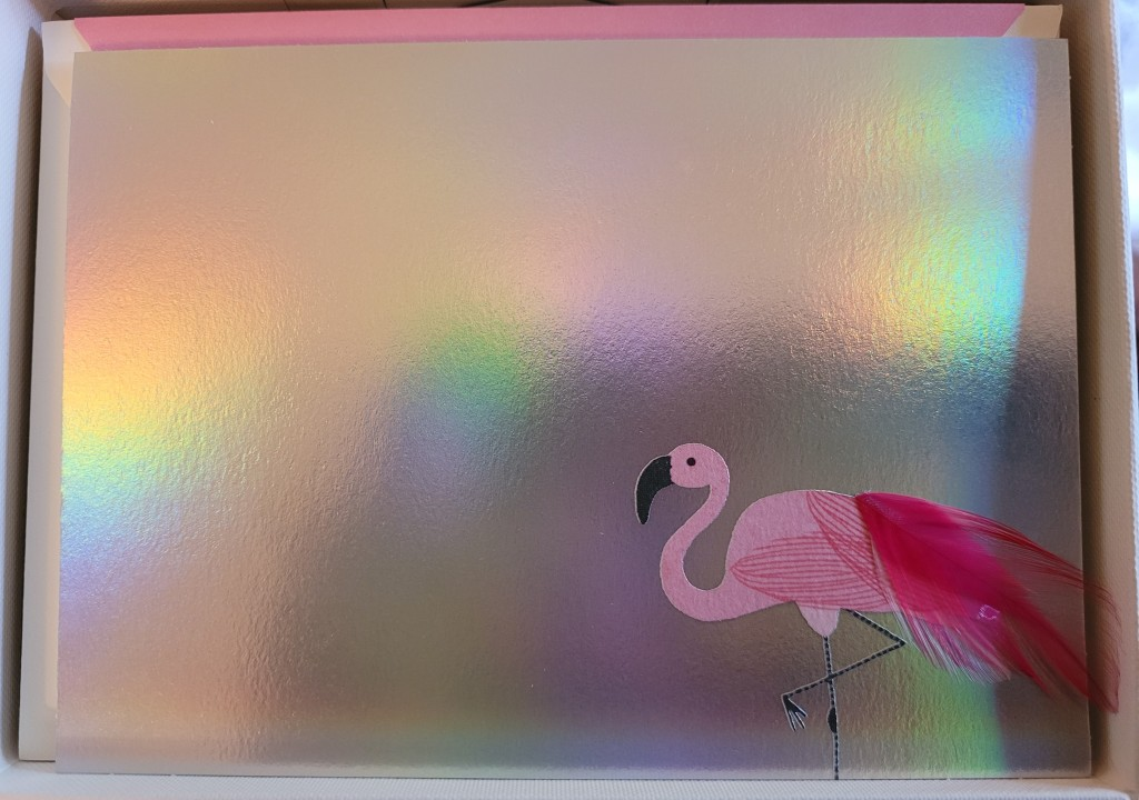 Notecard with an iridescent background and a pink flamingo in the corner