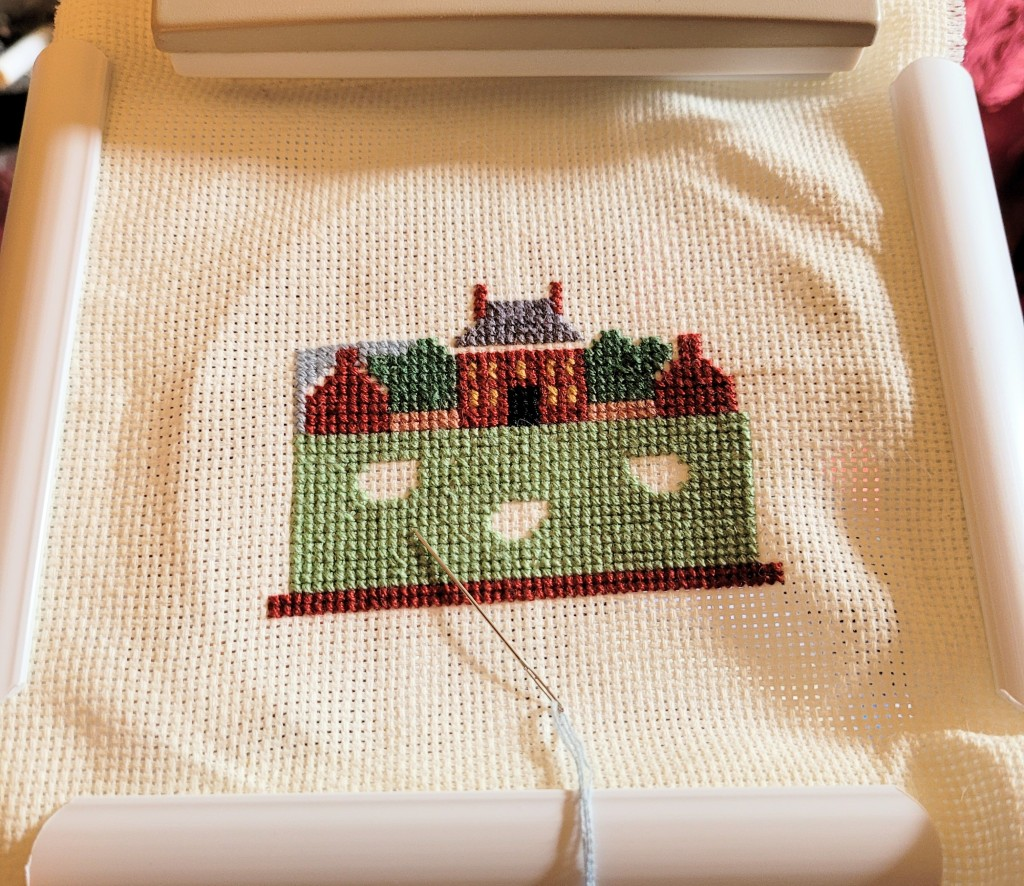 Cross stitch project of the Governors Mansion in Williamsburg Virginia