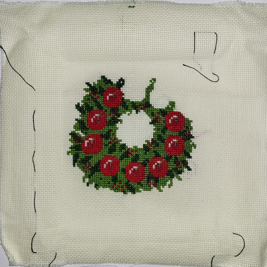 Christmas wreath cross stitch project, approximately 3/4 done!